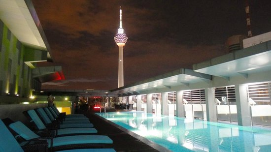 PARKROYAL Serviced Suites Kuala Lumpur:                   Roof top pool and tower at night