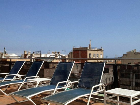 Sunotel Central:                                     The deck chairs next to the pool on the roof.