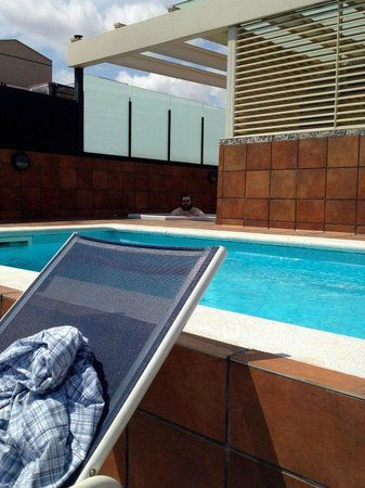Sunotel Central:                                     The pool and hot tub on the roof. Plus me drinking a smoothi