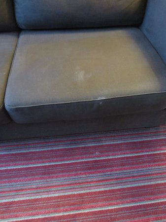 Best Western Hotel Du Pont Wilson:                   Body fluid stain on couch. . . dripping to floor.  Gross!!!