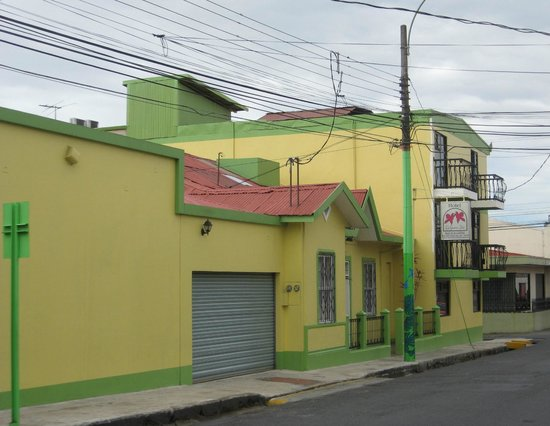 Hotel La Guaria Inn & Suites:                   Street view of well maintained exterior.