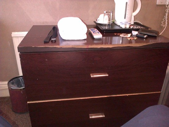 Newham Hotel:                   Chest of drawers, edge chipped off
