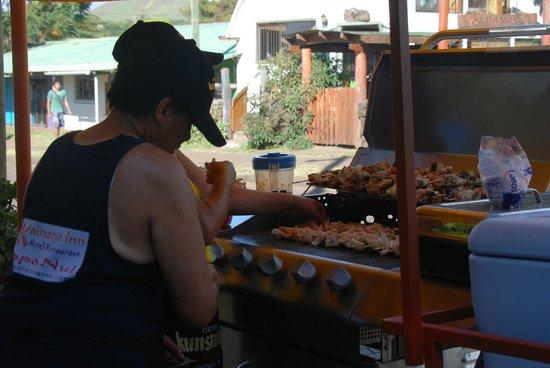 Kaimana Inn Hotel & Restaurant:                   Preparing Festival Food in front of the Restaurant                 