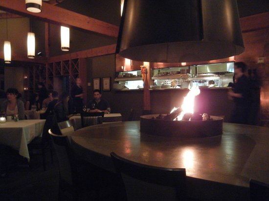 Barking Frog:                   Large Table Surrounding Fire Pit in Dining Room