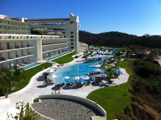 Secrets Huatulco Resort & Spa:                   Beautiful pools! THis is the quieter pool area. Swim up bar and entertainment