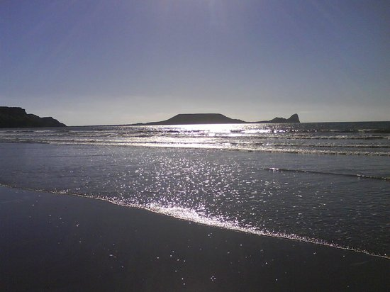 Rhossili Bay:                   Worms Head - from the beach as the sun sets