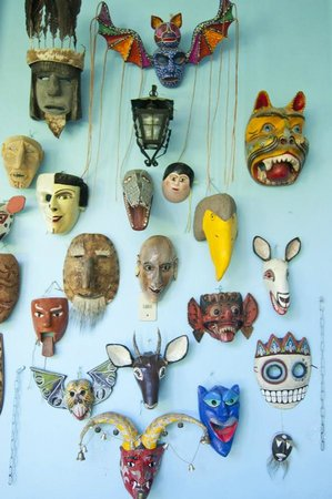 Casa Colonial:                   a wall of masks at the casa