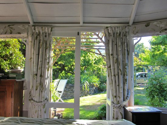 Mulberry House:                   View into the garden from inside the Summer House