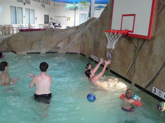 Palm Island Indoor Waterpark:                                                       pool with basket ball