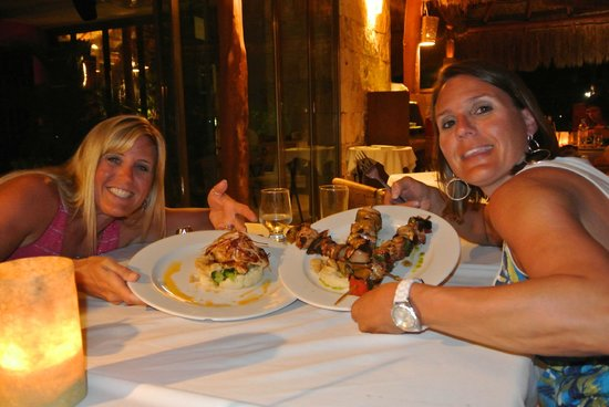 Origenes:                   Sisters with the grouper and chicken skewers.