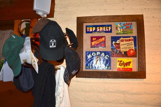 Nick's on the West Side:                   ball caps and can labels are the norm
