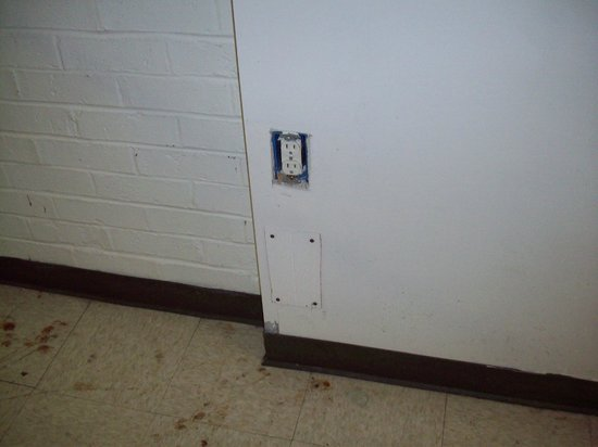 Super 7 Motel:                                     Utility area outlet cover missing