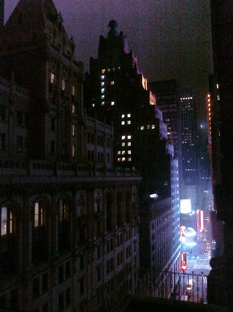 Hotel Carter:                   Nighttime view from our room window down 43rd St to Times Square. (05/2011)