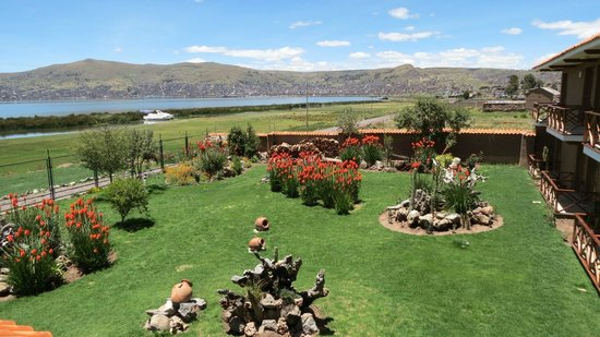 Casa Andina Premium Puno:                   Hotel grounds with Puno in the background