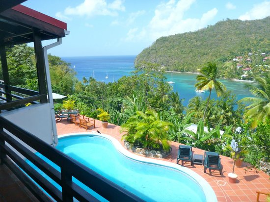 Marigot Palms Luxury Caribbean Guesthouse and Apartments:                   looking out harbor entrance