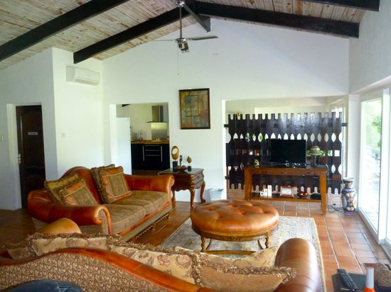 Marigot Palms Luxury Caribbean Guesthouse and Apartments:                   Living room to dining room