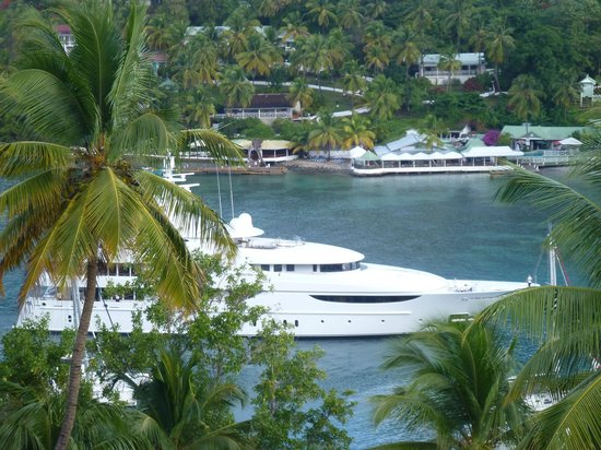 Marigot Palms Luxury Caribbean Guesthouse and Apartments:                   Oasis Yacht coming in