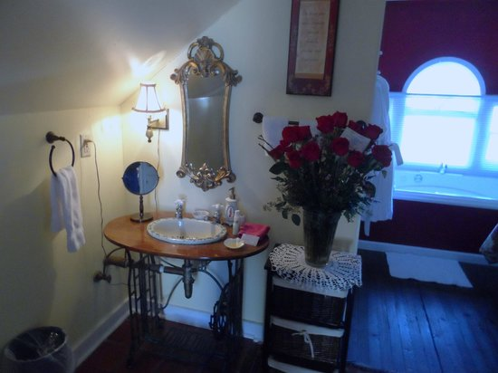 Penny Farthing Inn:                   vanity area...jacuzzi tub to the right rear