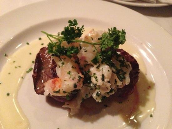 The Capital Grille:                   my steak with poached lobster tails.