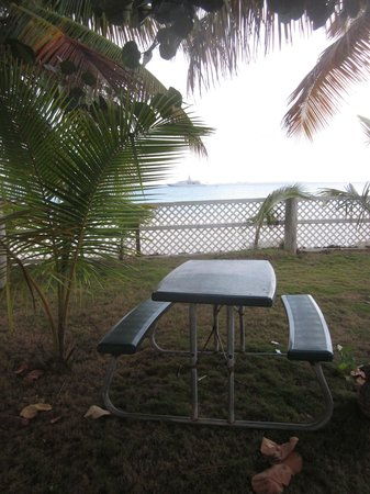 Anguilla Great House Beach Resort:                   Private-ish patio for room 127, Shaded spot with a beautiful view.