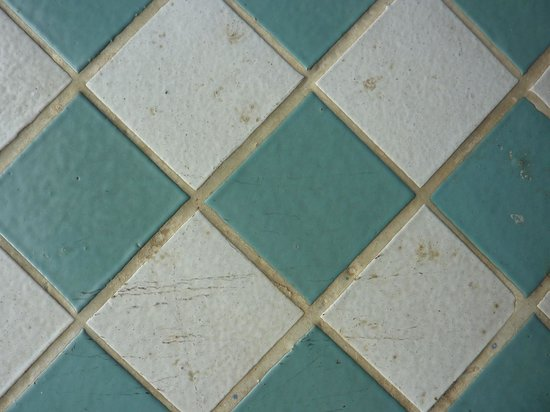 The Westin Resort & Spa, Cancun:                   Scuffed, dirty tile floor in room 1145