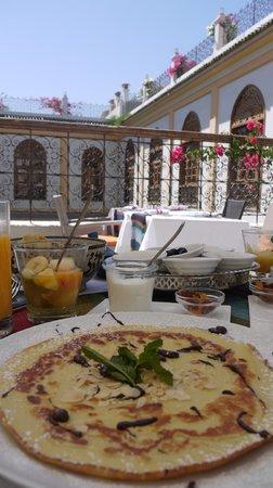 Palais Amani:                   daily gourmet breakfast on the patio