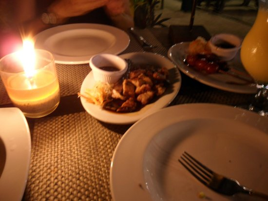 Dumaluan Beach Resort 2 :                   our dinner.. not yet complete.