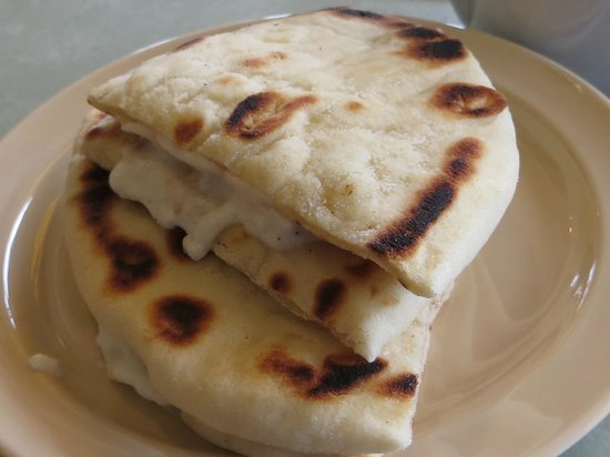 Jaffa Cafe Paso Robles :                   Pita bread with garlic sauce - I can eat 100s of it!