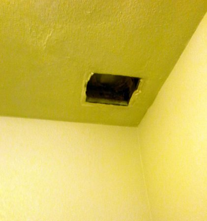 Sunshine Motel:                   Hole where ventilation fan should be, instead of on our toilet.