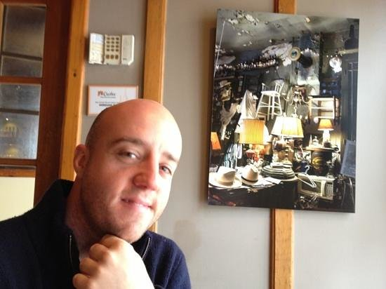 Le Croquembouche:                   My handsome husband and awesome wall art