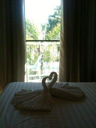 Turtle Inn Resort:                                     Lovely towel decoration on the bed.
