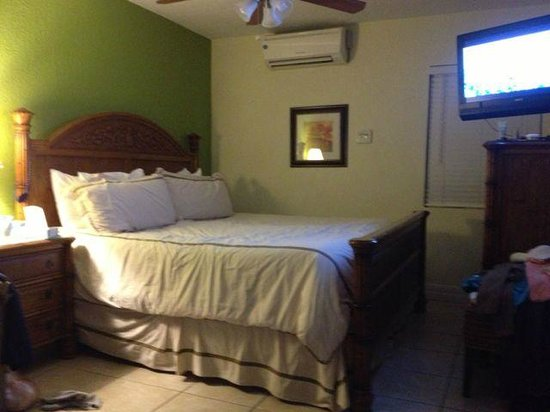 Tropical Beach Resorts:                   space is really tight between bed and dresser