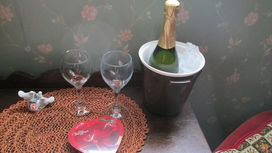 Heritage Manor Inn :                   Sparkling juice and glasses with chocolate