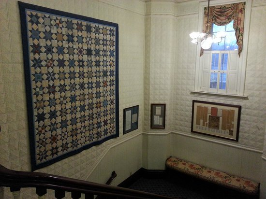 St. James Hotel:                                     Stairwell with antique quilt and other historical infomratio