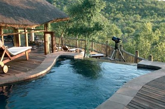 Etali Safari Lodge: Our infinity pool is open for the use of all guests and overlooks our waterhole.
