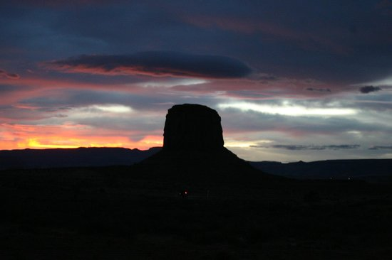 Monument Valley Navajo Tribal Park:                   Sunset as we left the park. This might be Mitchell Butte.