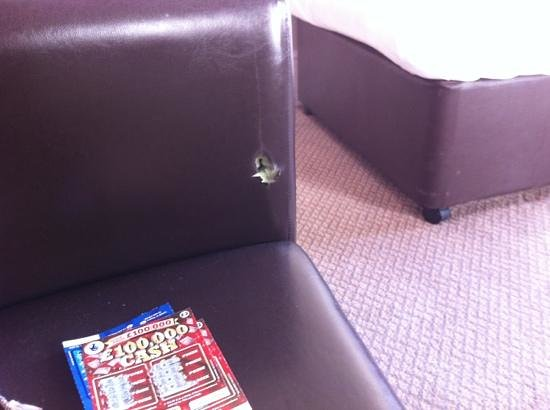 Queens Hotel:                   lovely comfy chair - with a hole