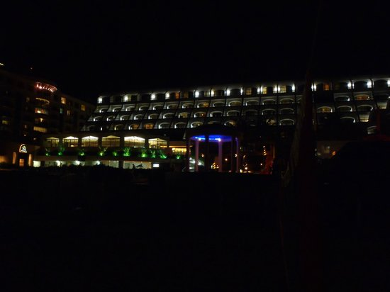 Golden Parnassus All Inclusive Resort & Spa Cancun:                   the resort at night from the beach