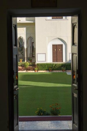The Raj Palace Grand Heritage Hotel:                   Gardens through the door