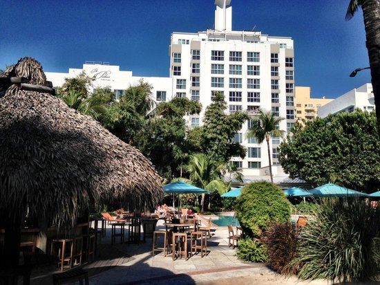 The Palms Hotel & Spa:                   Tiki bar and the poolside of the hotel