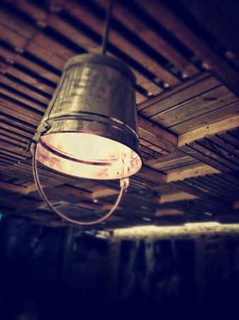 Pisco Bar :                   Cool lamps made from pails