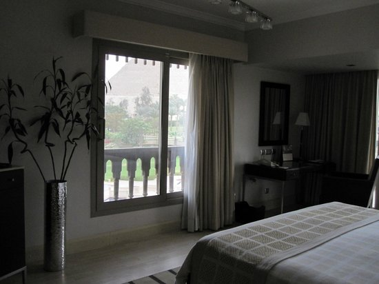 Mena House Hotel:                   views of the pyramids right in front of the bed!