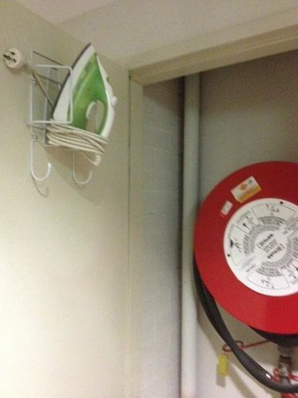 Dorsal Boutique Hotel :                   The ironing facilities safely tucked away in the fire hose cupboard.