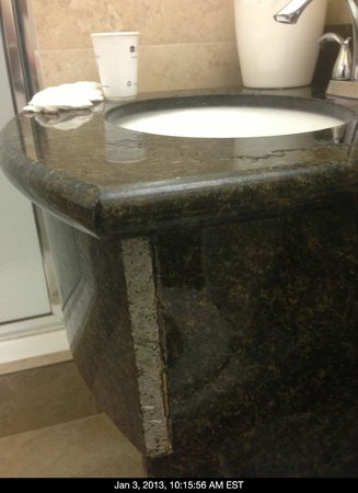 Best Western Bayfront:                   bathroom sink with rough edge