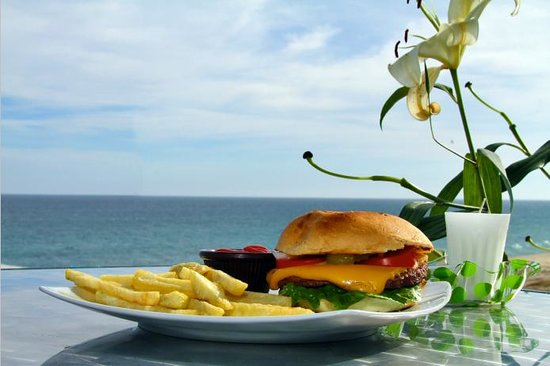 Crossroads Country Club:                   Okay, it's cliche... but, this really was a cheeseburger in paradise!