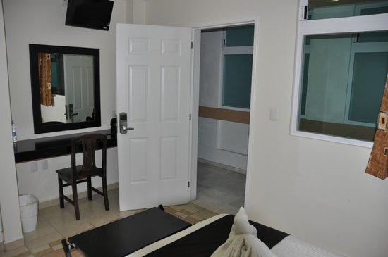 Hotel Irekua :                   Bedroom work area & view to hallway