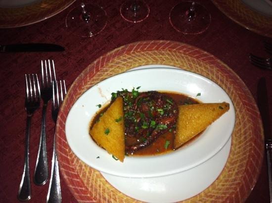 Sbrescia :                   Polipo alla Luciana con pane fritto