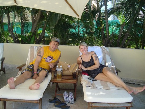 Casa Velas:                   Pam & Mike on loungers by pool at Beach/Ocean Club