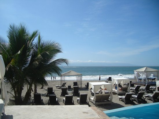 Casa Velas:                   Ocean/Beach club cabanas and loungers by infinity pool or on beach