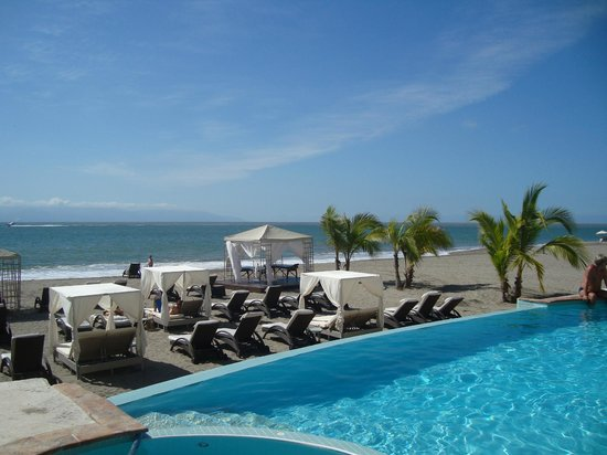 Casa Velas:                   Ocean/Beach  club looked beyond infinity poolto beach
